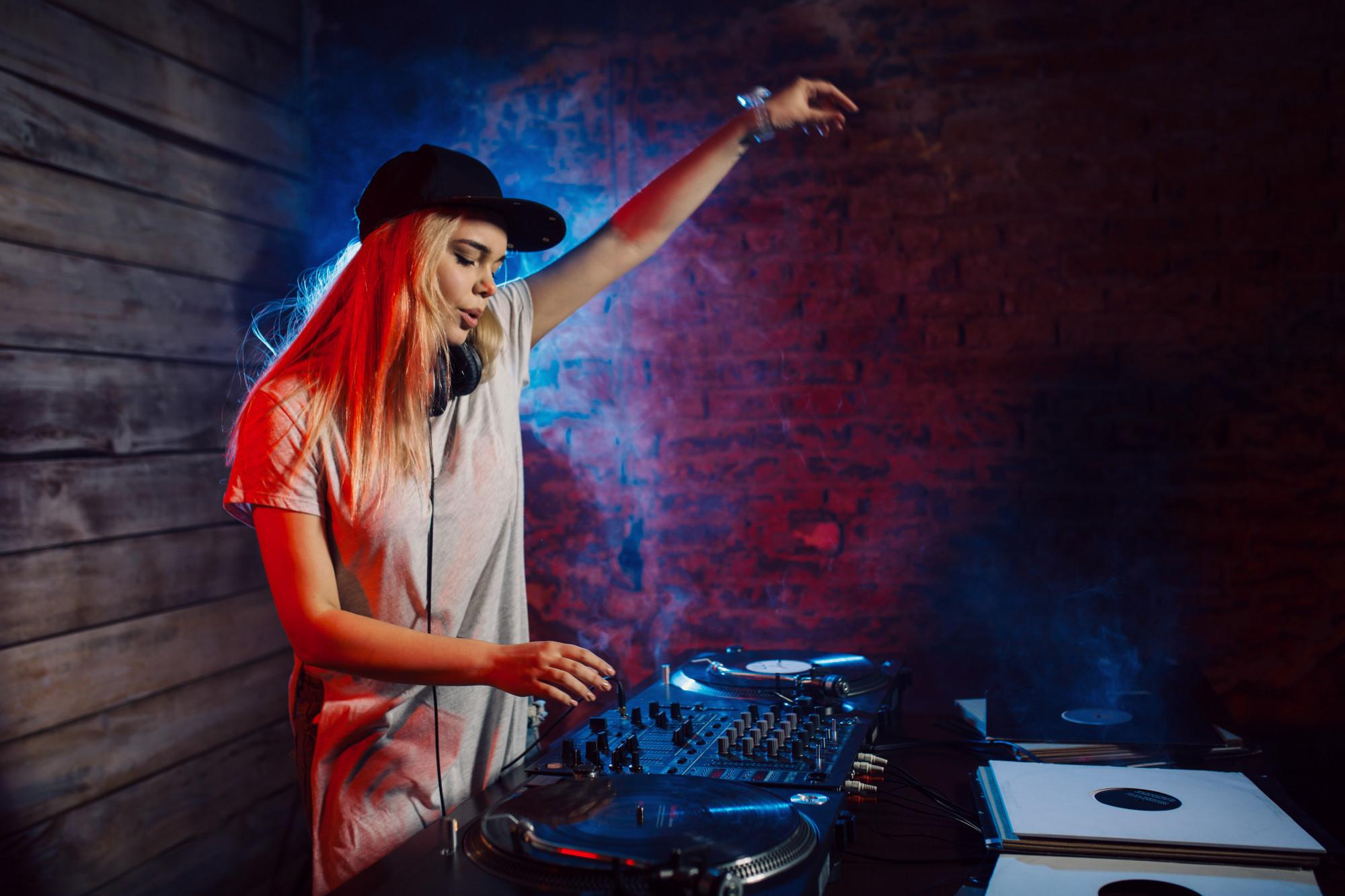 cute-dj-woman-having-fun-playing-music-club-party
