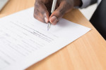 Musician signing recording contract with music distributor