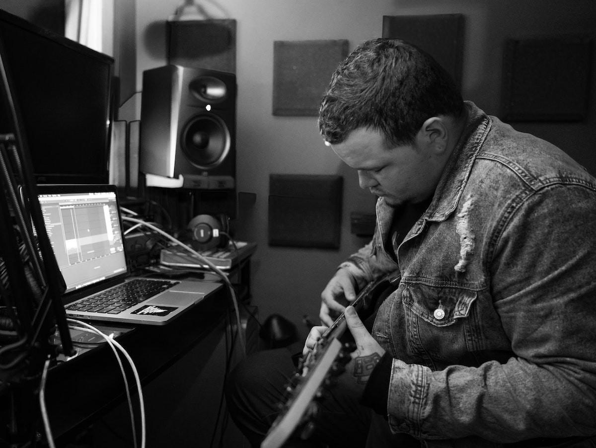 Musician taking an online guitar course