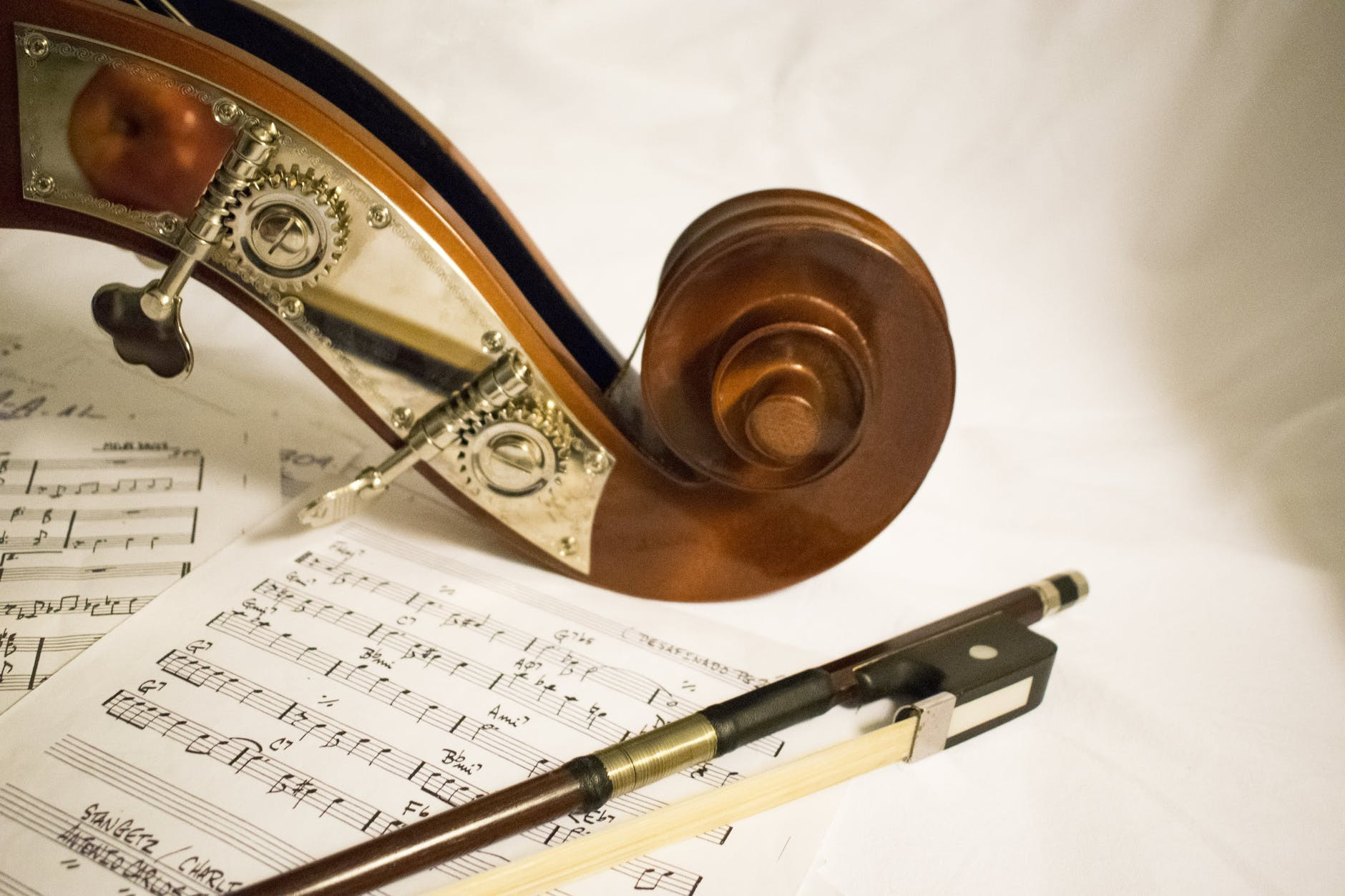 Sheet music and cello for musician's mechanical royalties